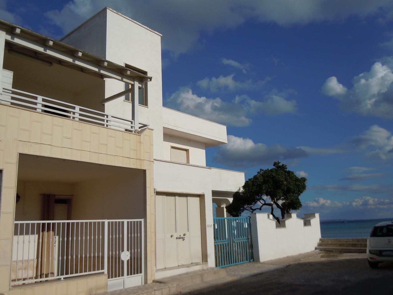 Piso sulla spiaggia affitto appartamento vacanze torre for Appartamento oltre il costo del garage